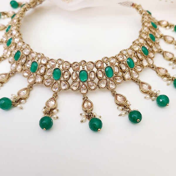 South Asian choker necklace set with gold zircon diamonds and emerald green accents on 22k gold plating