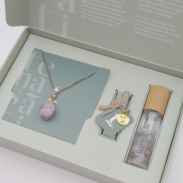 As nature intended in raw cut form, this amethyst necklace set is on display with a selenite wand and specially blended roller tube filled with essential oils of your pickings. Currently showing the Lavender Sun expression.