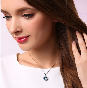 CDE 925 sterling silver necklace embellished with Swarovski crystals blue circle pendant