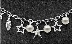 CDE Glass pearl bracelet with rhodium plating embellished with Swarovski crystals