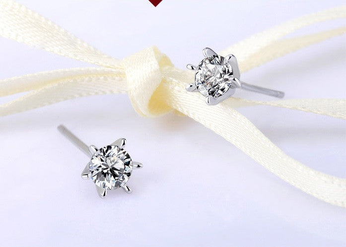 CDE Sterling silver 925 star earrings with rhodium plating embellished with Swarovski crystals