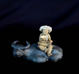 "1.75""L x 1.25""H Cow with Man Sitting on Back Mudmen Bonsai Figurine"