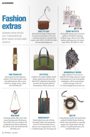 BOUTIQUE MAGAZINE FEATURES TOVI SORGA'S BLACK LEATHER PLEATS TOTE WITH NEON ORANGE LINING