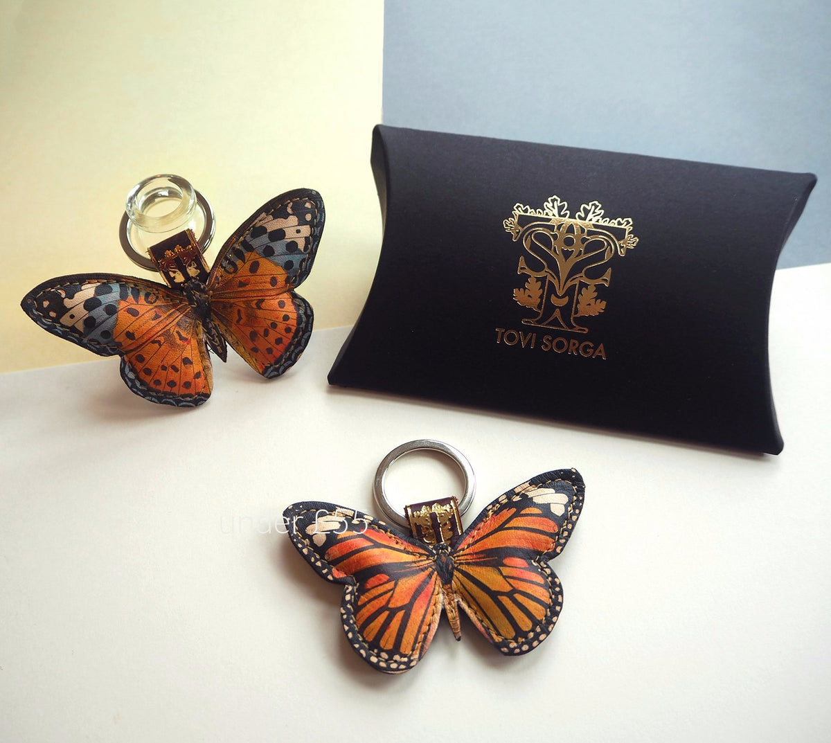 Leather gifts for women: Monarch butterfly bag charm / key ring: red and blue butterfly by UK accessories brand Tovi Sorga