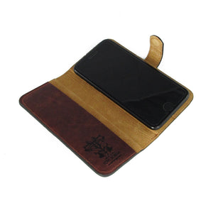 Genuine brown leather phone case. 100% real leather phone case. Folio wallet designer flip phone case by Tovi Sorga.
