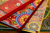 Notebooks with aboriginal art covers.
