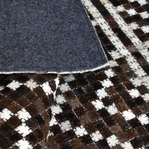 edensor hide rug in brown and ivory color