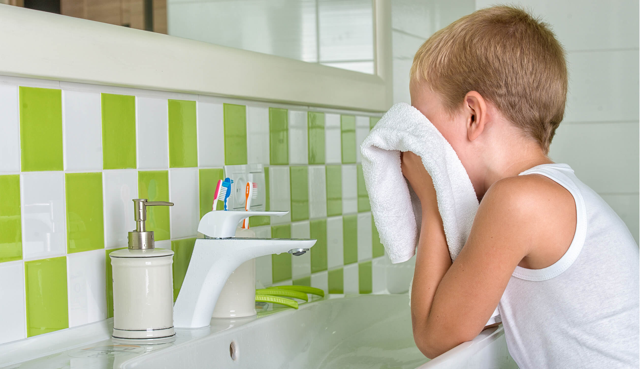 a boy washes his face.jpg