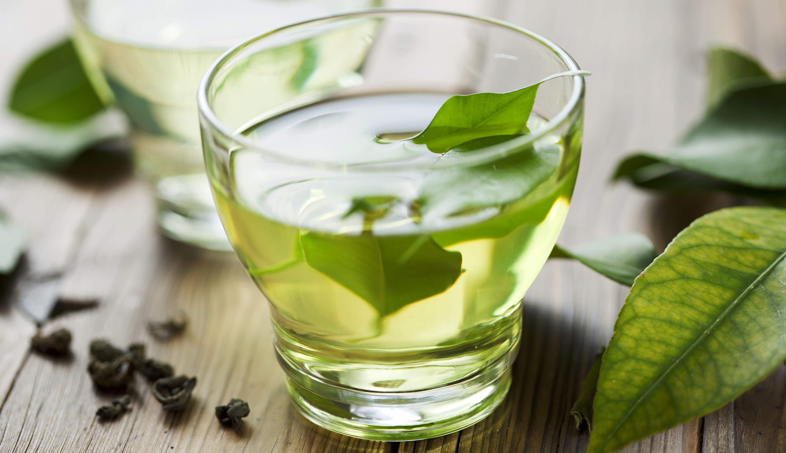Green tea leaves in cup