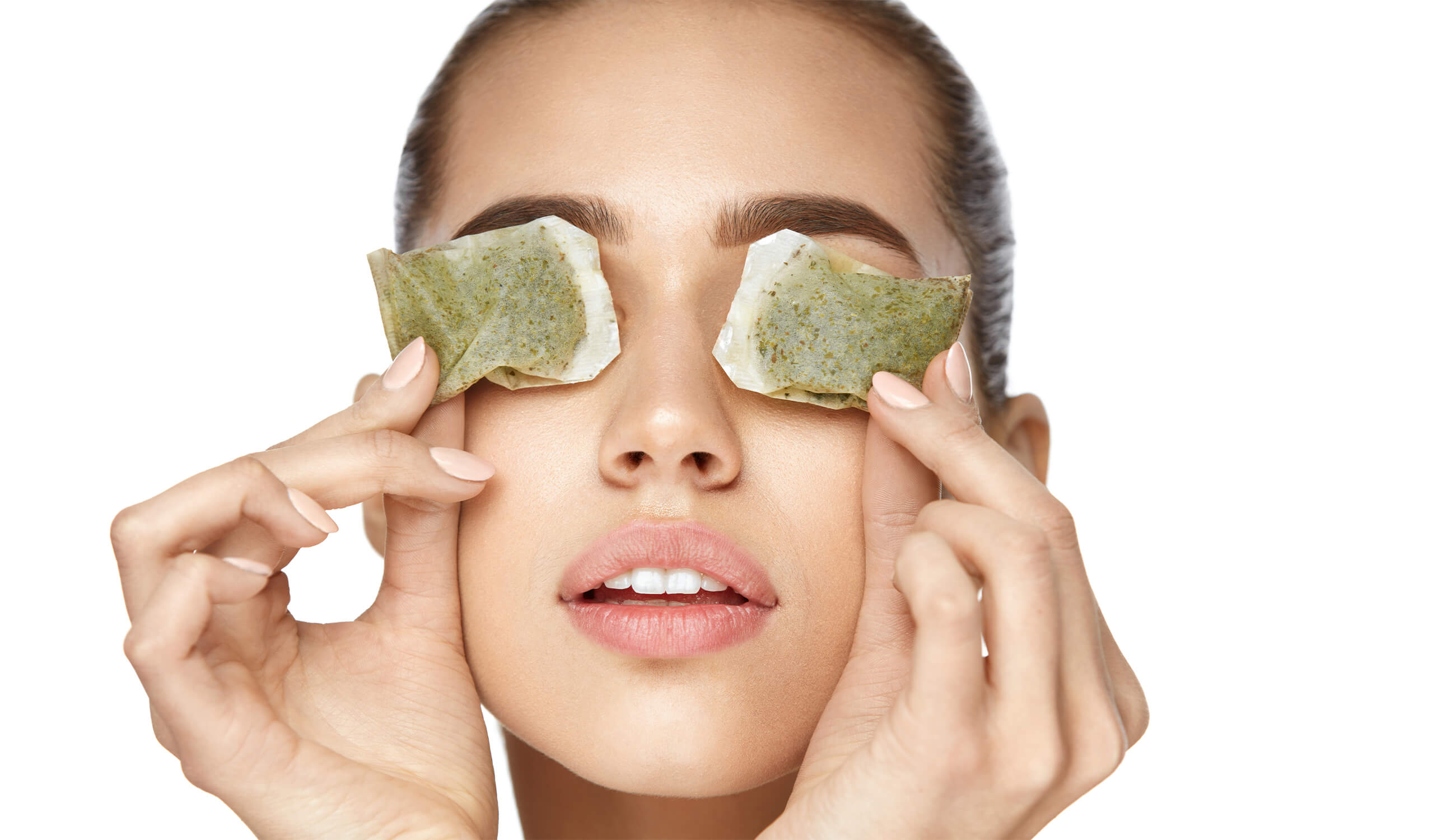 Woman With Green Tea Bag Under Eyes