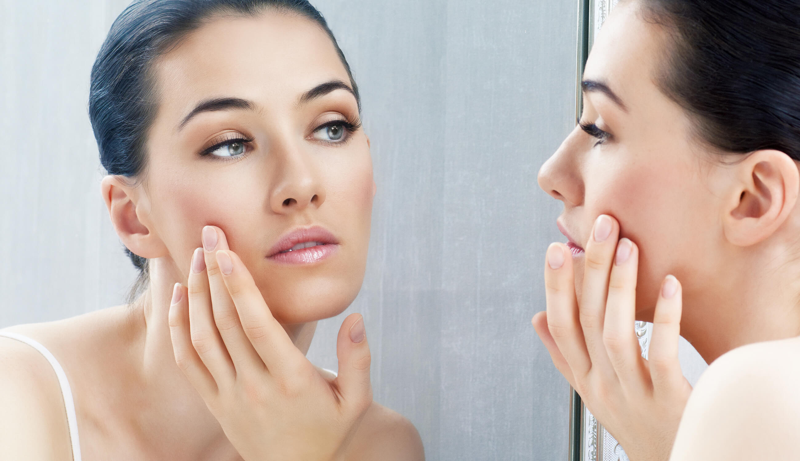 checking skin for acne