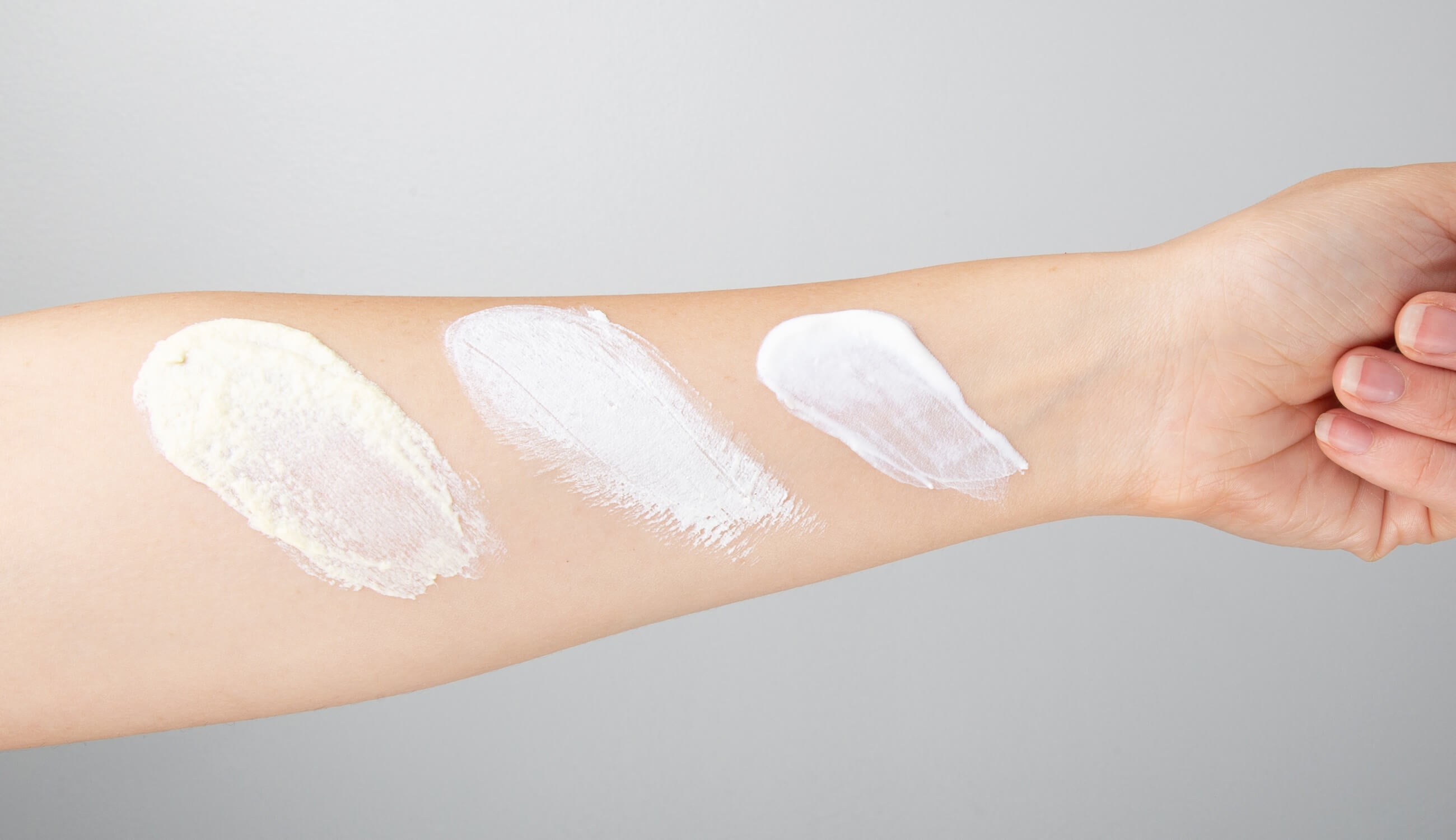 Different sunscreen swatch on arm