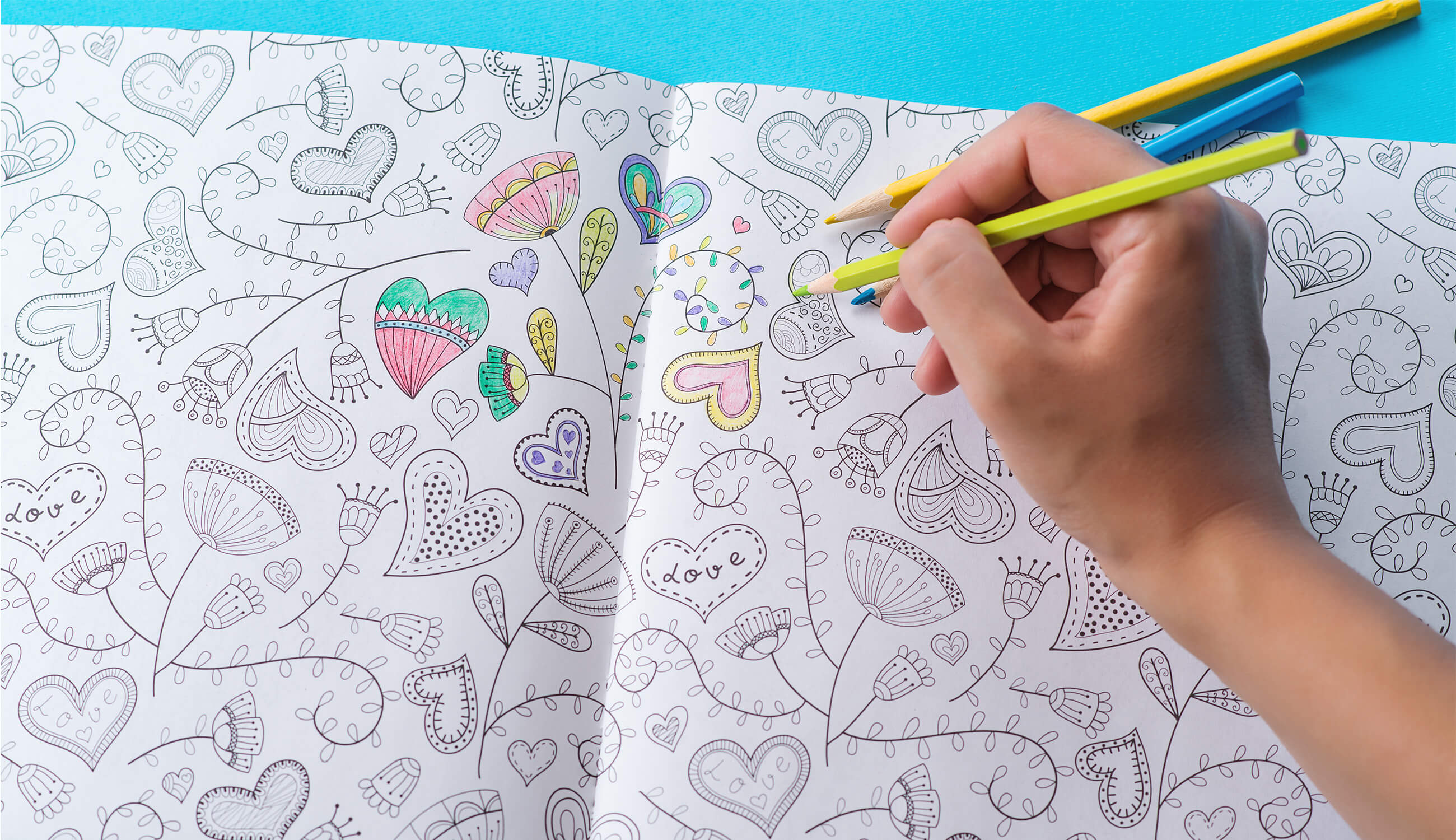 hands coloring in coloring books