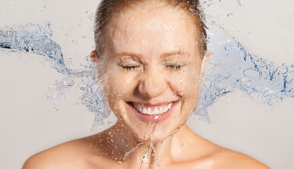 Main_woman's face being splashed with water.jpg