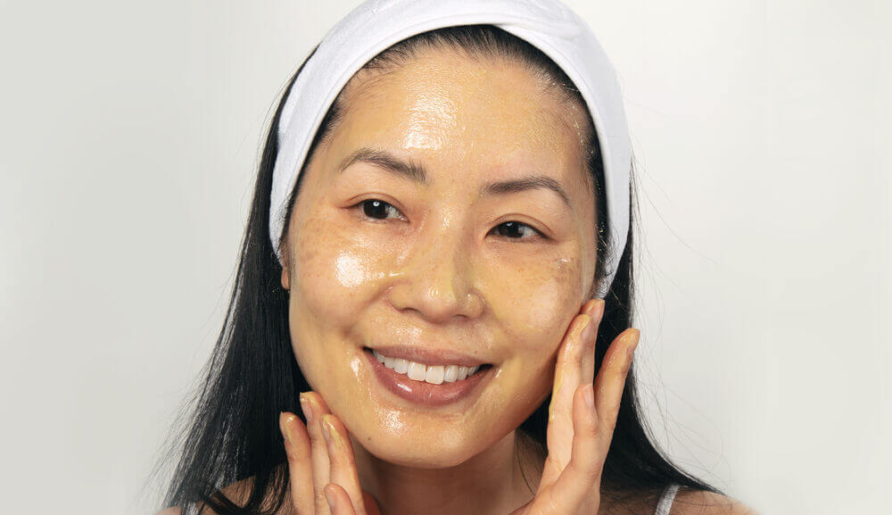 Person wiping face with wash rag.jpg