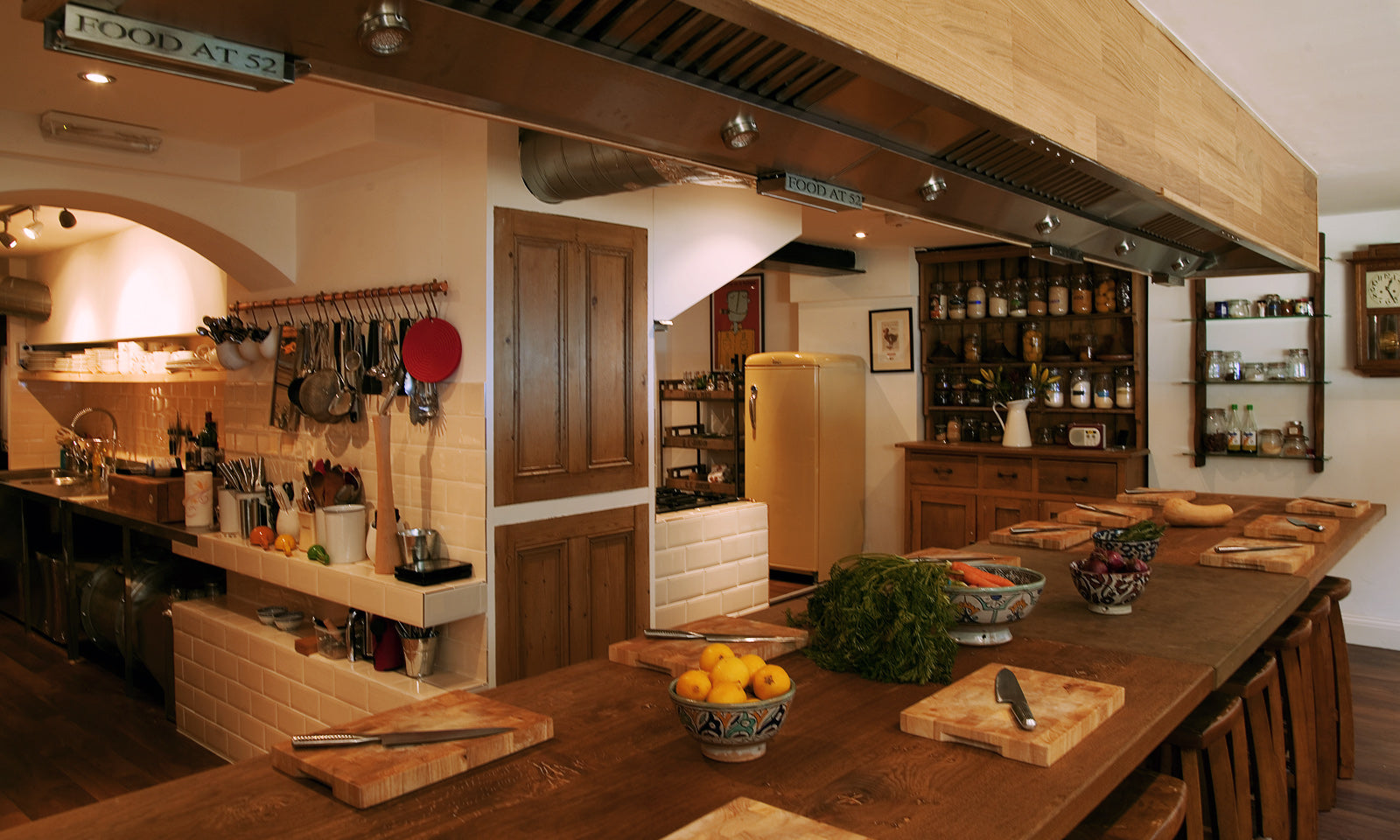 The rustic oak banquet table in our kitchen with a view of the pantry and scullery.