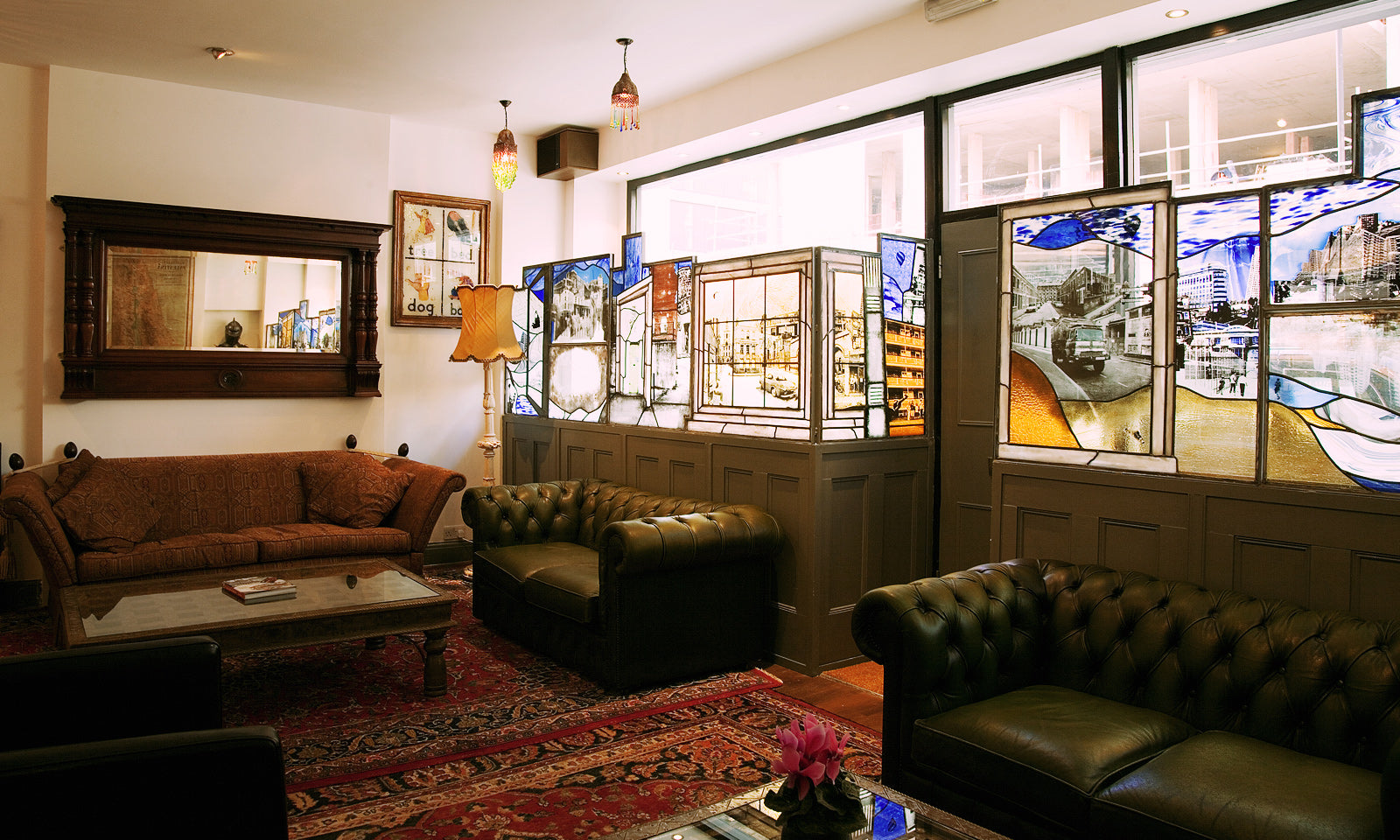 Painted glass windows in our upstairs lounge add warmth and atmosphere.