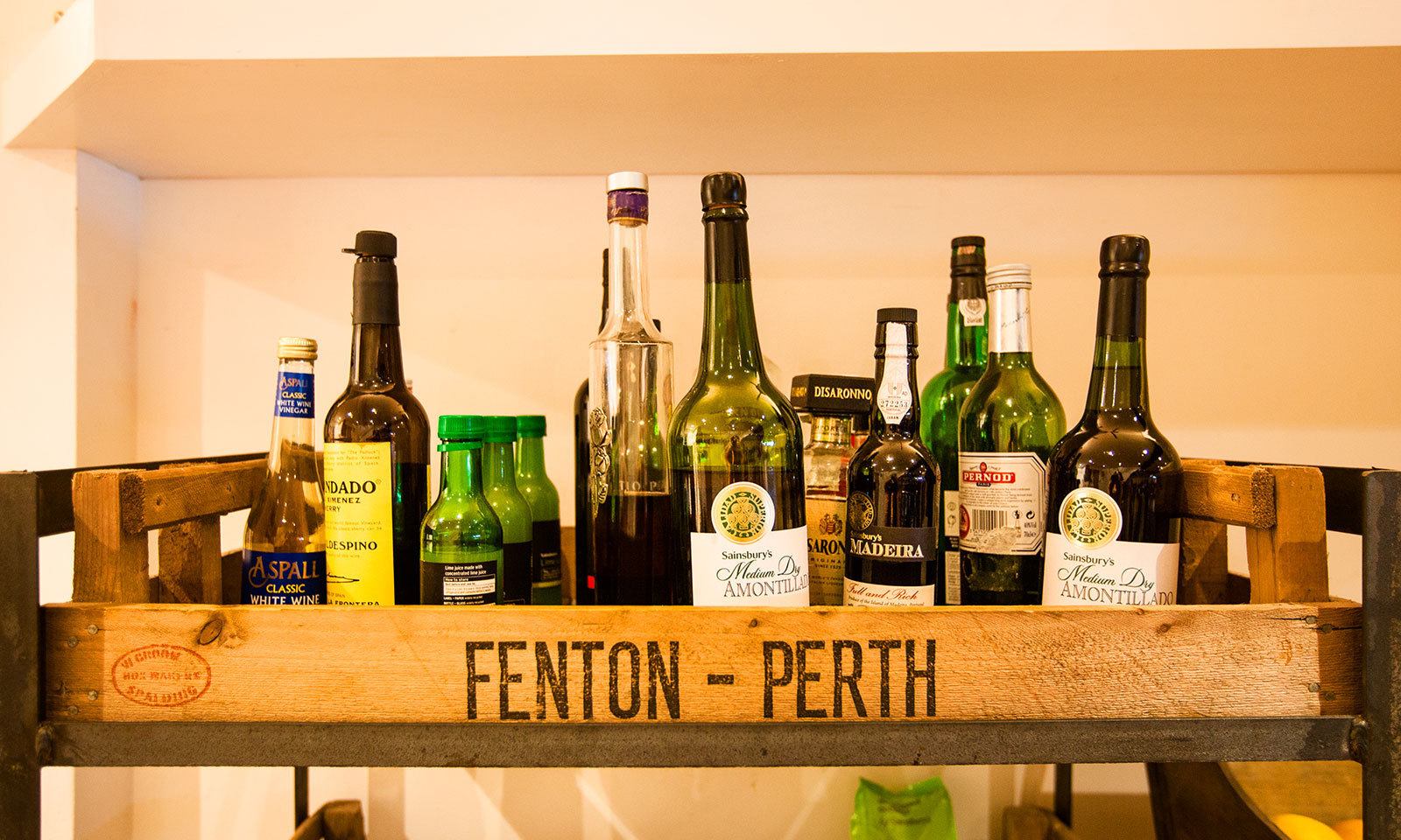 Spirits and vinegars on display in our kitchen.