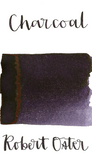 Robert Oster Charcoal is a dark grey fountain pen ink with a strong purple undertone and low shading.