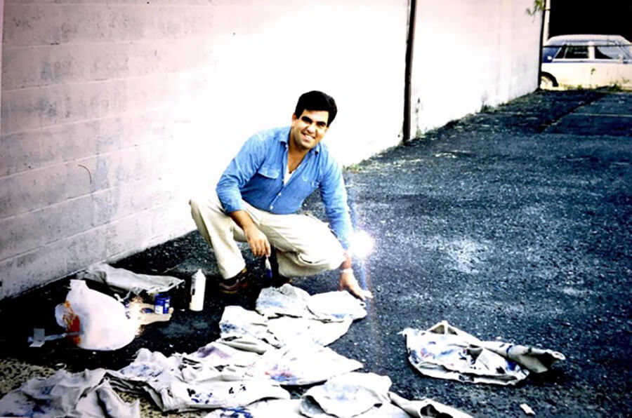 Eric working on production in a parking lot for RRL in 1994, hand distressing jeans