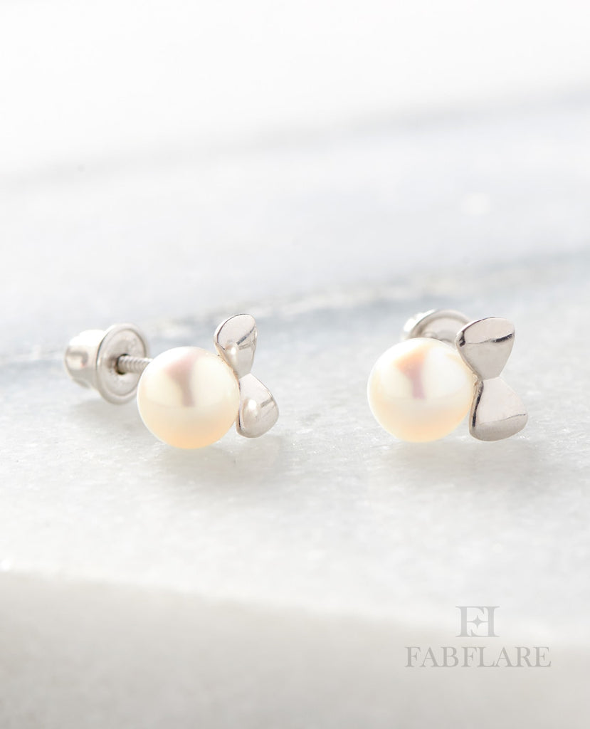 White Freshwater Cultured 4mm Pearl Stud Bow Design Earrings in 14k Yellow Gold