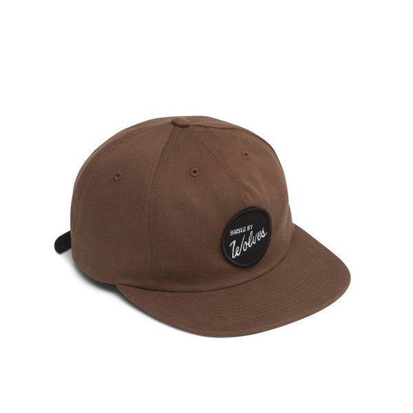 Raised by Wolves - Varsity Polo Cap - Nutmeg