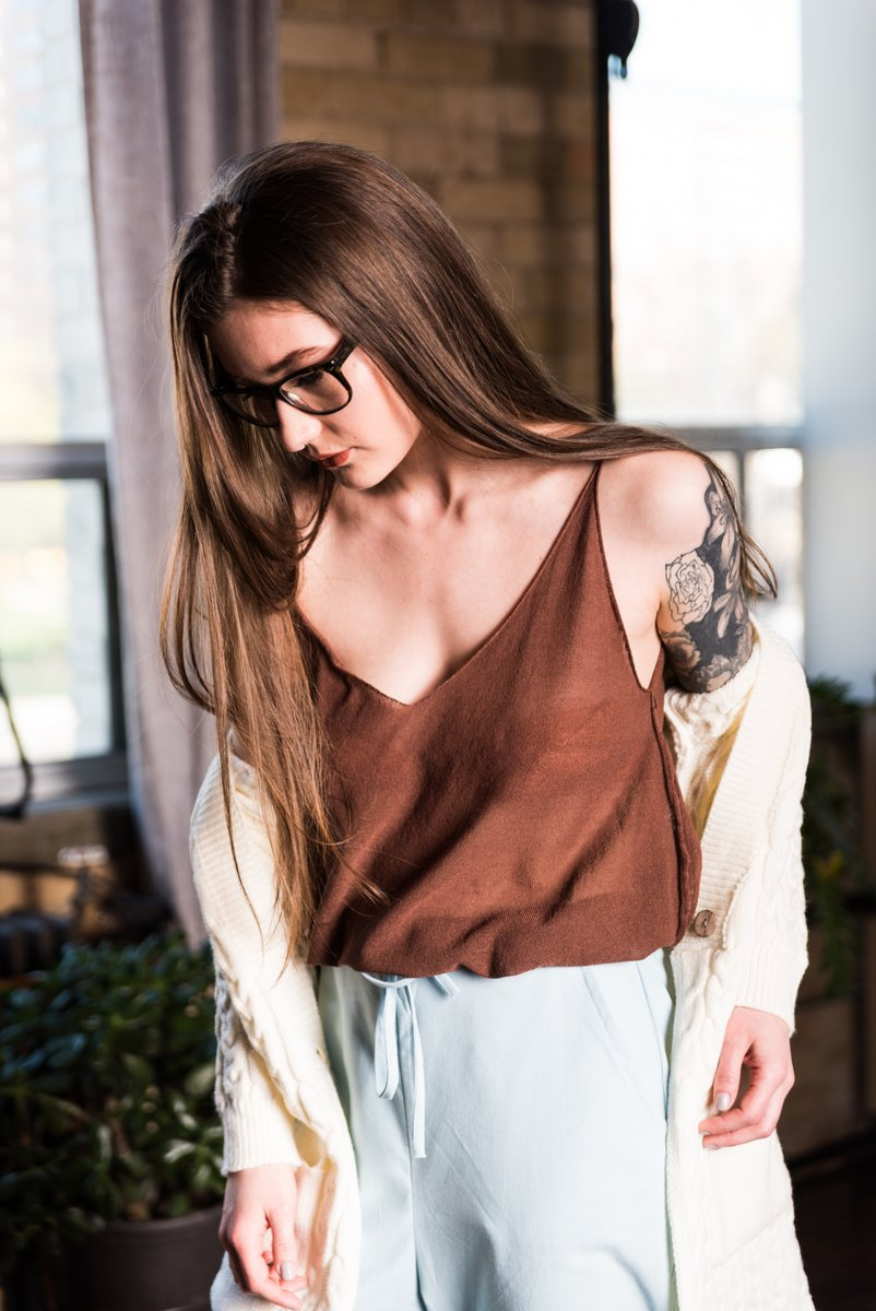 Brown Sleeveless Sheer V-Neck Tank Top That has Loose Fitting and is Lightweight