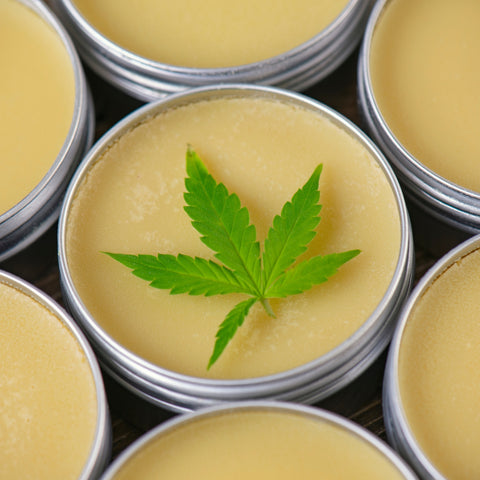 infused lotions with cbd - yellow cream with a thc leaf on top