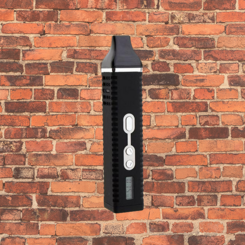 Titan 2 dry herb vaporizer in front of a brick wall