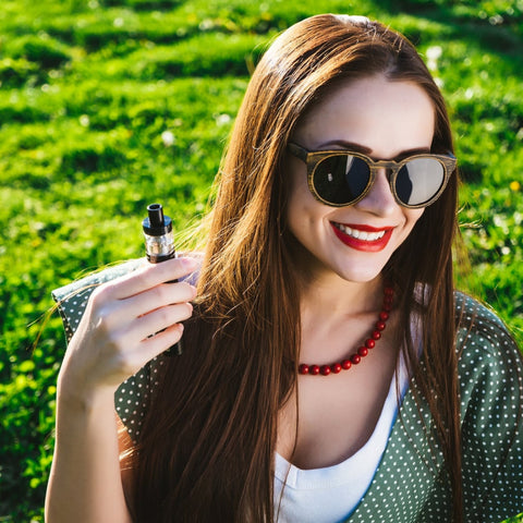 Freebase salts being vaped by a girl in a park