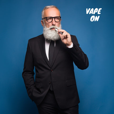 man vaping in a suit and tie with text saying vape on and blue background