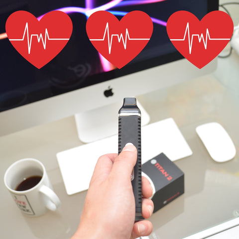 three red heart beating with a dry herb vaporizer being held in front of a computer