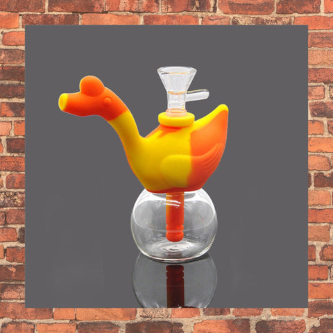 Orange and Yellow silicone bubbler with clear glass bottom brick background