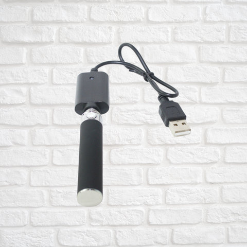 Vape Charger with brick white wall