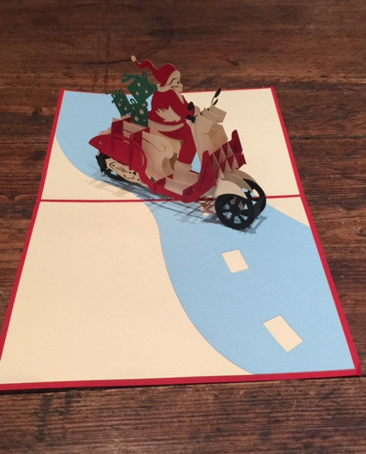 Santa Riding a Scooter (Blue Presents)