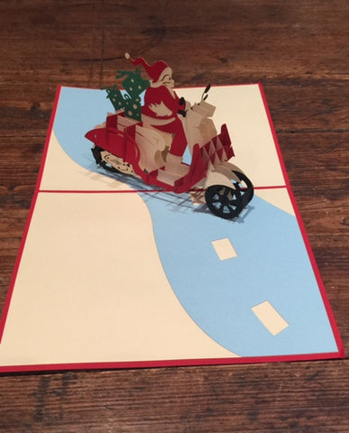 Santa Riding a Scooter Christmas Card