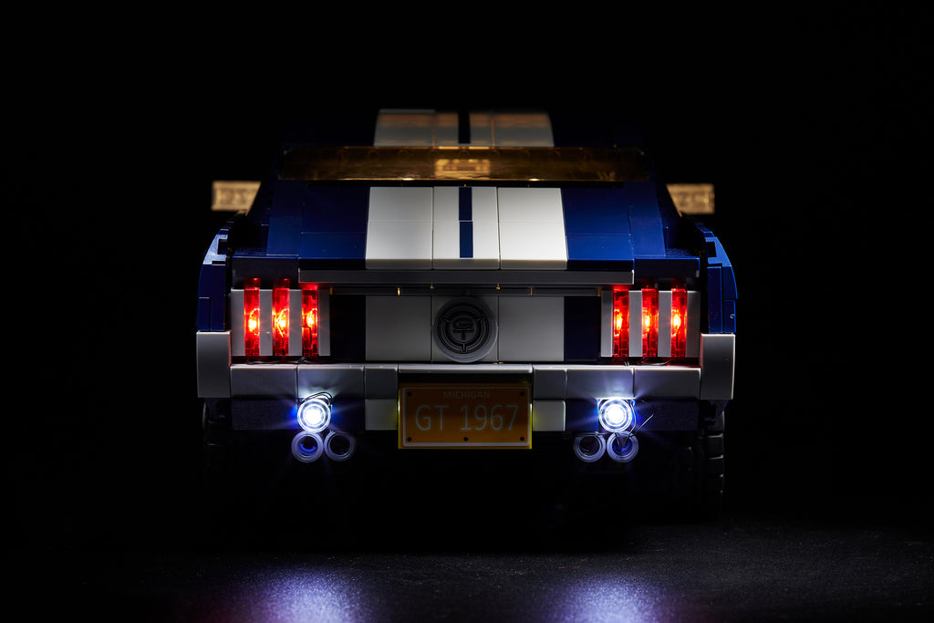 Close-up of the back of the blue LEGO Ford Mustang set 10265, with the custom Brick Loot LED Light kit installed.
