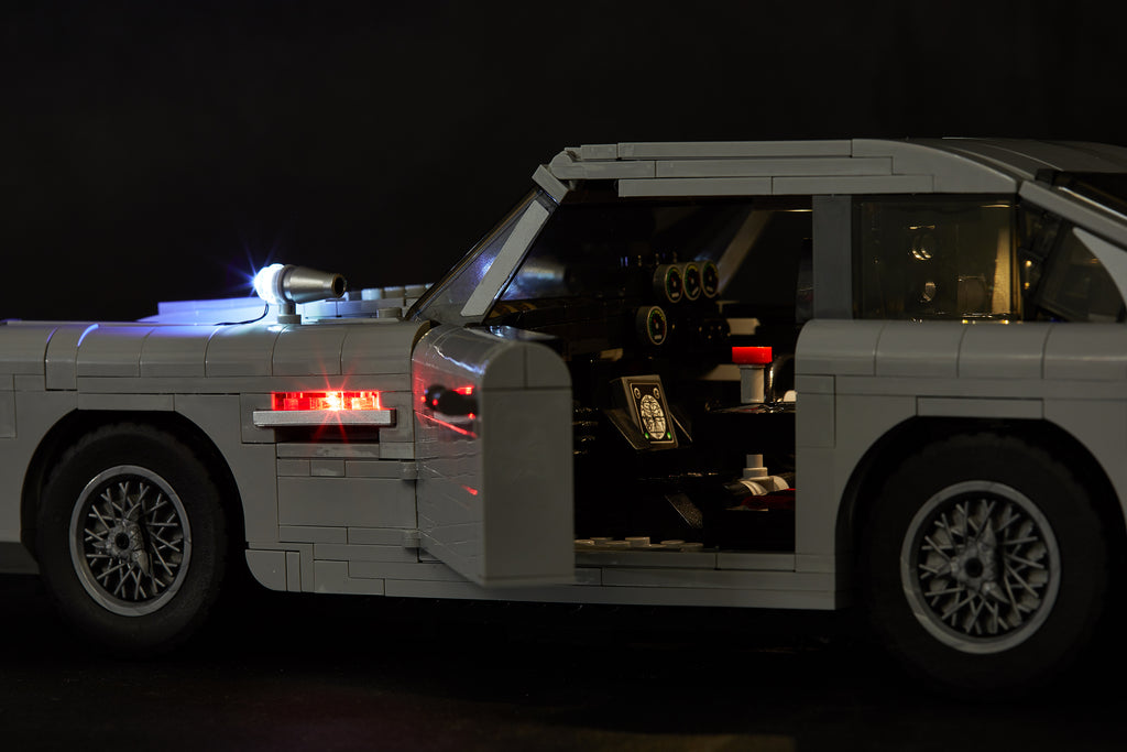 Side view of the LEGO James Bond Aston Martin DB5 model - set 10262; the interior and exterior is illuminated with the Brick Loot custom LED light kit.