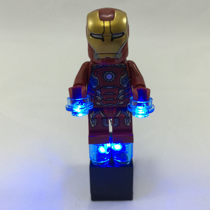 Brick Loot Lights for LEGO - Blue LED Lights powered by a black 2x3 battery brick (AG3 batteries included). Shown here with Iron Man minifigure (not included). In the picture, the lights are on.