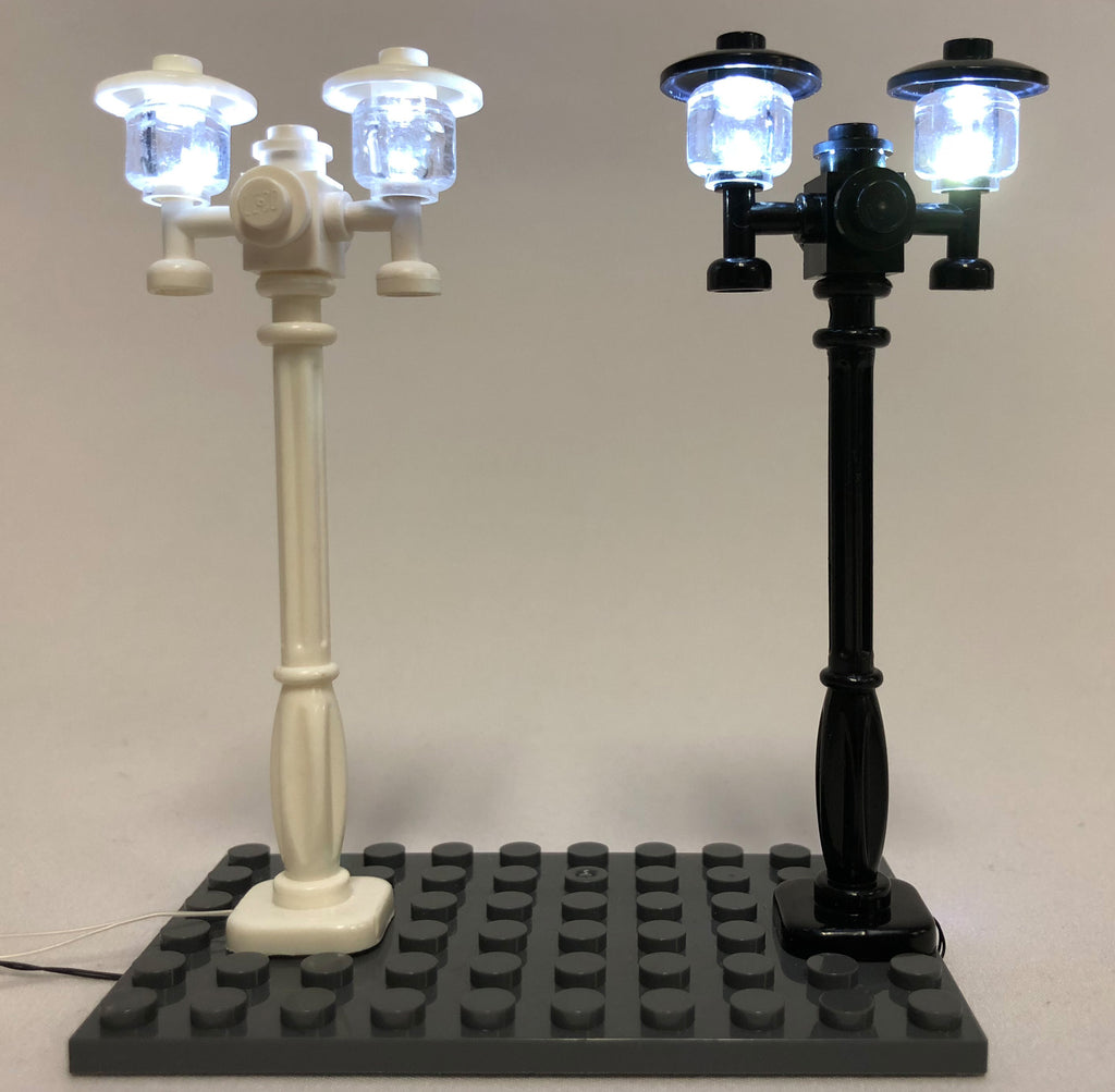 Brick Loot LED Lighting for LEGO - Double Light Street Lamp for LEGO Cities in Black or White, each powered through USB. In this photo, the lights are on.