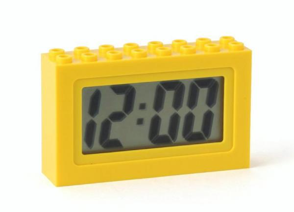 Small digital clock inside a bright yellow brick (LEGO inspired) case.  Sold by Brick Loot