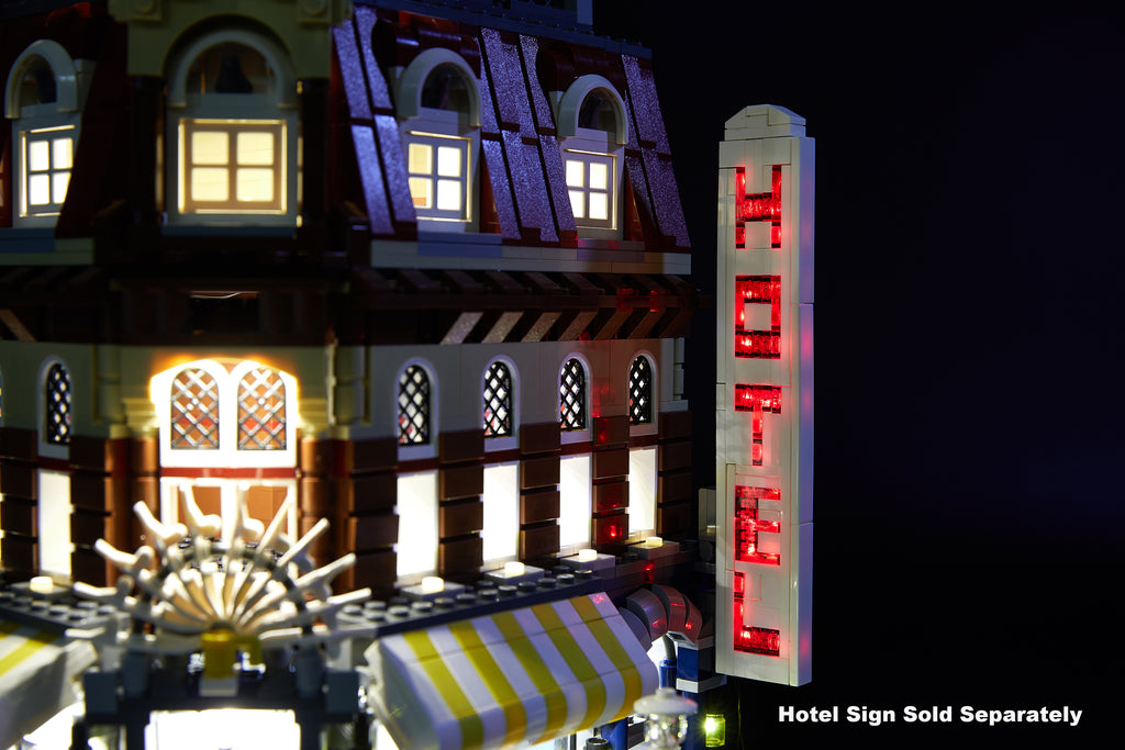 Close of the LEGO Cafe Corner set 10182 with the Brick Loot optional flashing Hotel sign and full light kit installed.