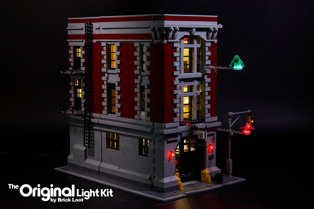 Exterior of the LEGO Ghostbusters Firehouse Headquarters set 75827, illuminated with the Brick Loot LED Light Kit.