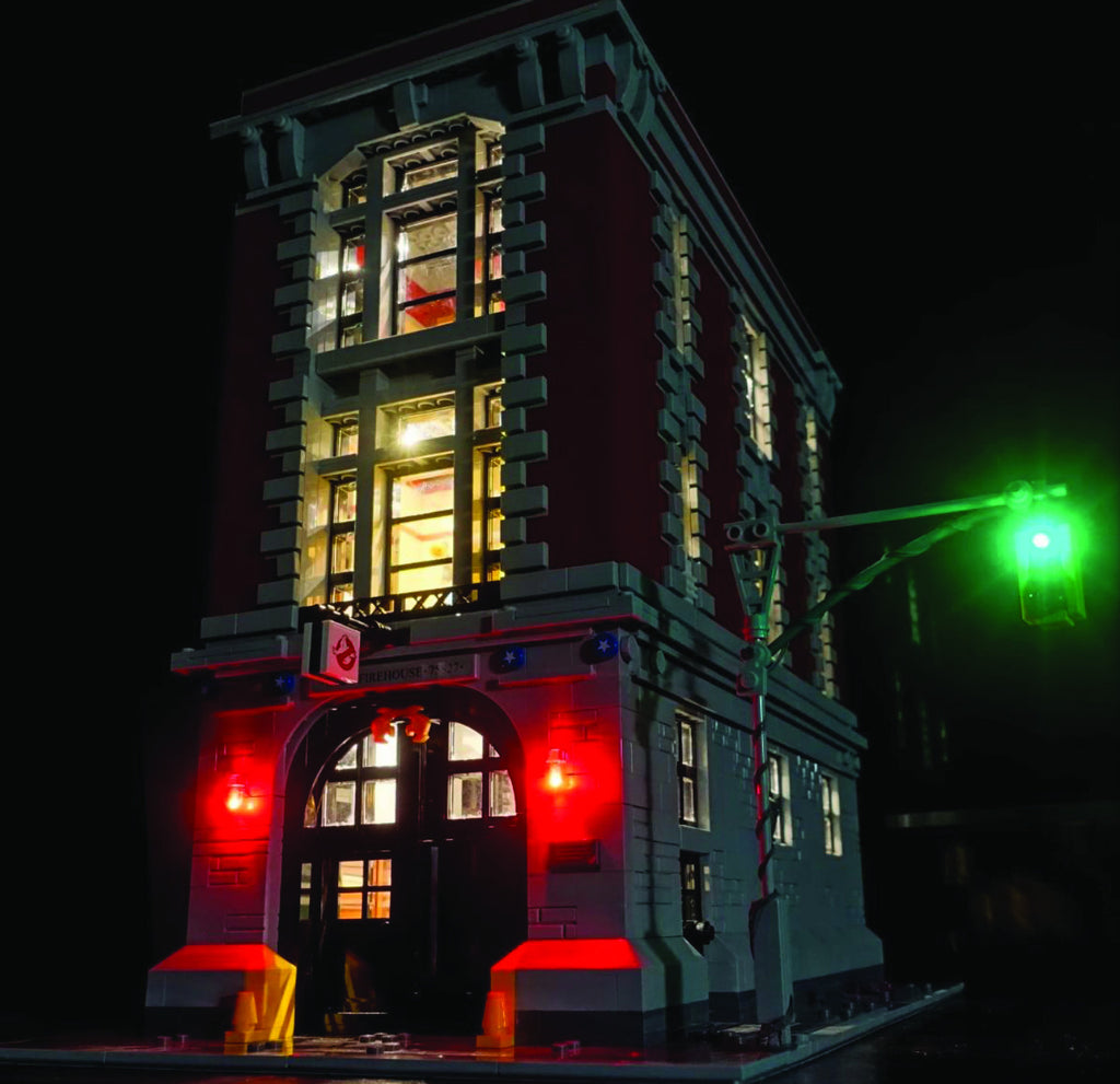 LEGO Ghostbusters Firehouse Headquarters set 75827, illuminated with the Brick Loot LED Light Kit.