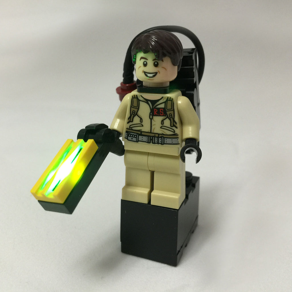 Brick Loot LED Light Kit for LEGO - Ghostbusters Ghost Trap Light with 2x3 Black Battery Brick (2 AG3 batteries, included). Shown here with minifigure (minifigure NOT included). In this photo, the light is on.