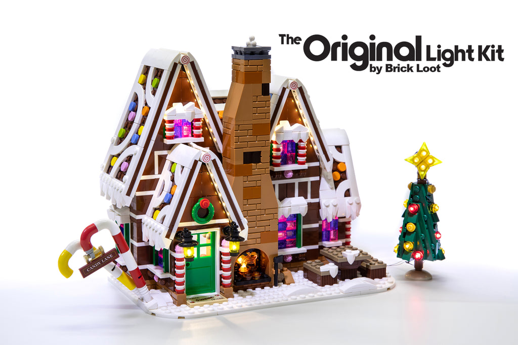 Exterior of the LEGO Gingerbread House set 10267, illuminated with the Brick Loot LED Light kit! The light kit includes lights for the Christmas tree and fireplace! Beautiful day or night!