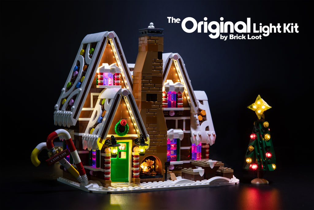 Exterior of the LEGO Gingerbread House set 10267, beautifully illuminated with the Brick Loot LED Light kit! The light kit includes lights for the Christmas tree and fireplace!