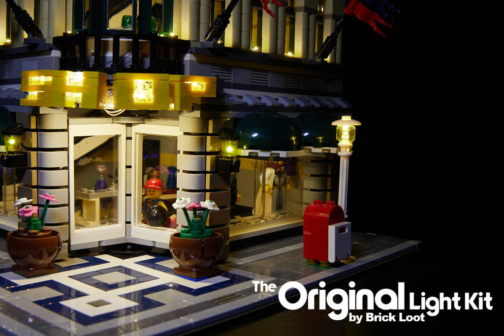 Close-up of the exterior of the LEGO Grand Emporium set 10211 with the Brick Loot LED Light Kit installed.