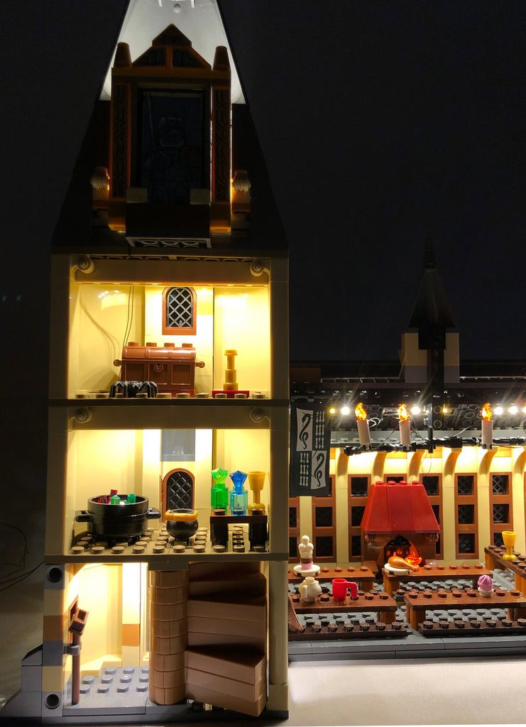 Close-up of the interior of the LEGO Hogwarts Great Hall set 75954, with the Brick Loot LED Light Kit.