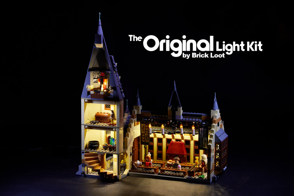The interior of the LEGO Hogwarts Great Hall set 75954, glowing with the Brick Loot LED Light Kit installed.